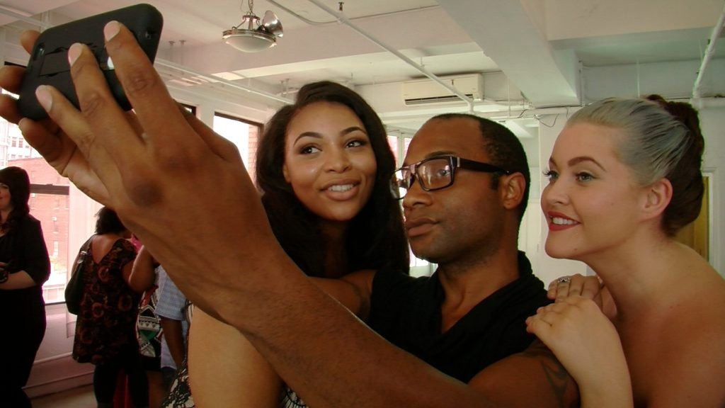 Plus models Candice Kelly and Peaches pose for a selfie with Duke n Dutchess designer, Tyrell Holmes